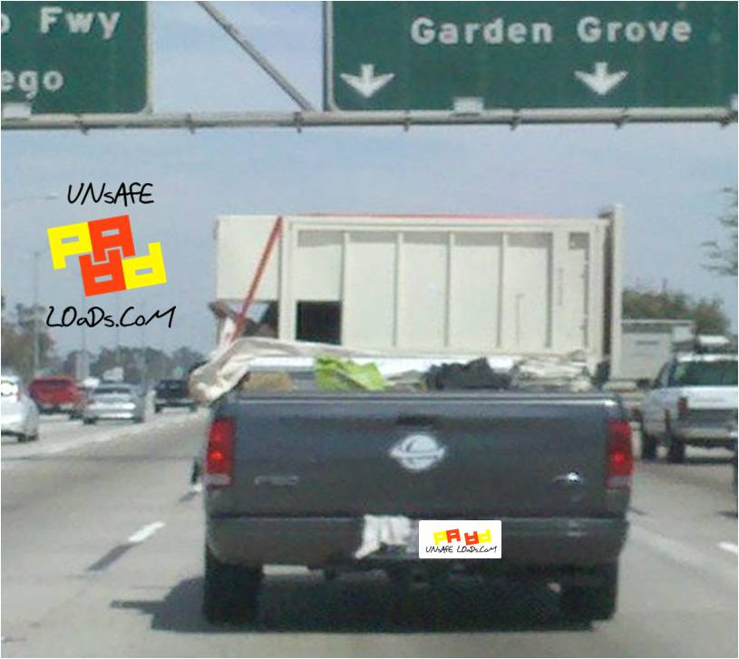 Unsafe Pickup Truck on the Freeway